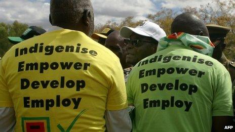 Robert Mugabe greets supporters (July 2013)