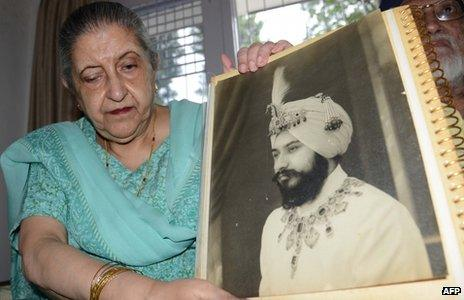 Amrit Kaur, the daughter of the late Maharaja of Faridkot- Harinder Singh Brar, poses with a portrait of the Maharaja at her residence in Chandigarh on August 2, 2013