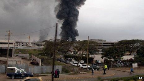 Dark smoke rises from the Jomo Kenyatta International Airport in Nairobi, Kenya, on Wednesday