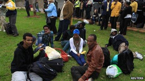 Stranded passengers and onlookers gather after a fire disrupted all operations at the Jomo Kenyatta International Airport in Kenya's capital Nairobi on Wednesday