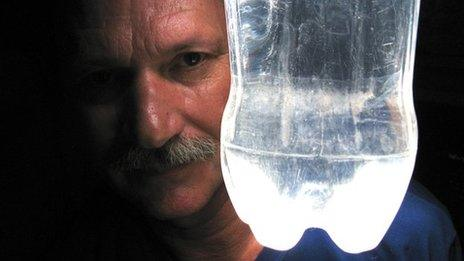 Alfredo Moser with one of his bottle lights