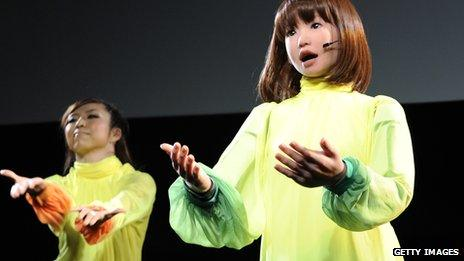 Japan's HRP-4C robot, dancing and singing with live performers in Tokyo