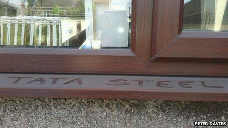 Words Tata Steel written in dust on external window sill at Port Talbot home of Peter Davies