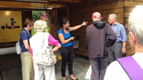 Social workers explain to Zurich residents how things work at the compound
