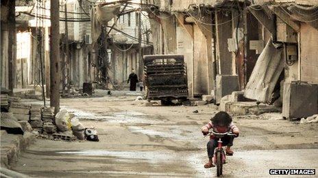 Little girl on bike in Damascus