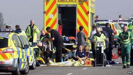 Paramedics treat people at the scene