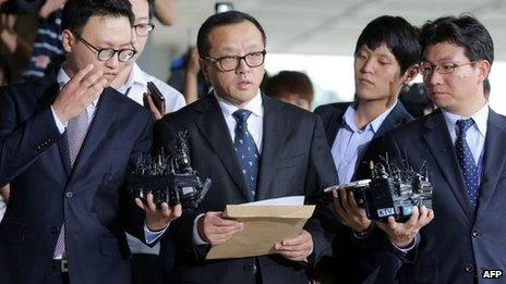 Chun Jae-Kook (C), eldest son of former South Korean President Chun Doo-hwan, speaks to the media at the Seoul Central District Prosecutors Office in Seoul on 10 September 2013