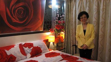Lam Wai-lung in one of the rooms in her hotel