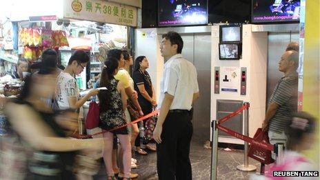 People waiting by the lift inside Chungking Mansions
