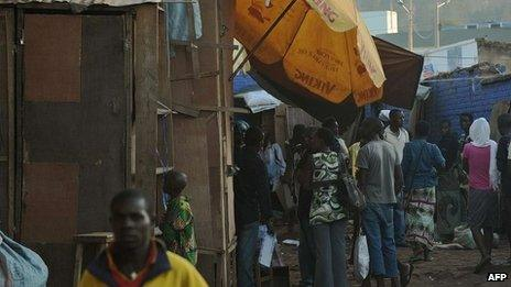 People gather at the scene of a blast at Kigali's main market