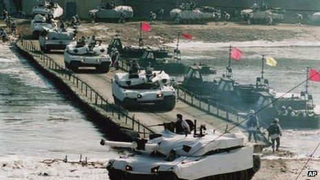 South Korean Army tanks cross the Hantan River in Yonchon county, north of Seoul, during military exercise against imaginary North Korea attack Wednesday