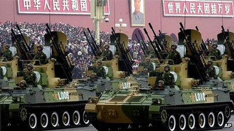 A convoy of armoured vehicles heads towards Tiananmen Square on Friday, Oct. 1, 1999 in Beijing as part of the celebrations for the 50th anniversary of China under communist rule.