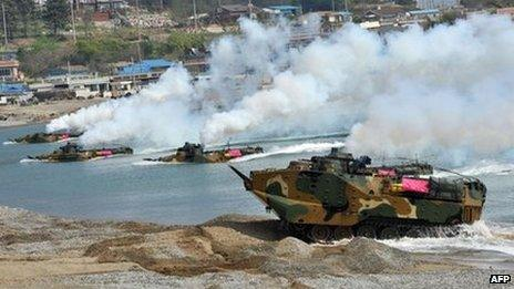 South Korean Marine amphibious assault vehicles land on the seashore during a joint landing operation by US and South Korean Marines in Pohang, 270 kms southeast of Seoul, on April 26, 2013.