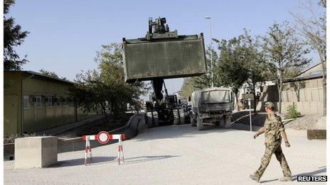 A truck transports a military container in the German army camp in Kunduz (2 Sept 2013)