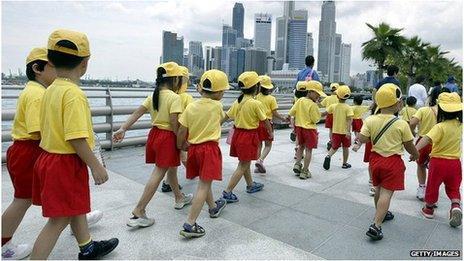 School children walking in a crocodile in Singapore