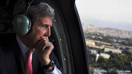 US Secretary of State John Kerry looks out a helicopter window en route Kabul. Photo: 11 October 2013