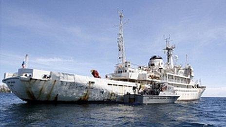 Venezuelan Coast Guard boat sits next to the 285-foot survey ship Teknik Perdana docked near the shore in Margarita Island, Venezuela, Sunday Oct. 13, 2013