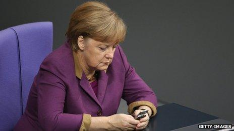 German Chancellor Angela Merkel checks her mobile phone during a session of the Bundestag (30 November 2012)