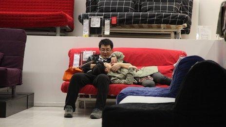 A couple on a sofa in Ikea