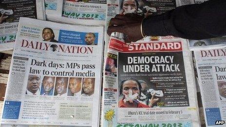 A newspaper vendor sells newspapers carrying headlines commending a new media bill on 1 November 2013 in Nairobi. Kenya
