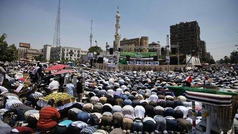 Thousands of Morsi supporters kneel during Friday prayers at the start of the sit-in at al-Rabaa al-Adawiya Mosque