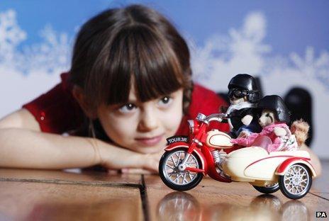 Girl staring at toy