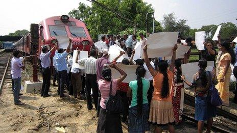 Pro-government activists block a train carrying Britain's Channel 4 television crew who made an award-winning documentary on alleged war crimes in Sri Lanka