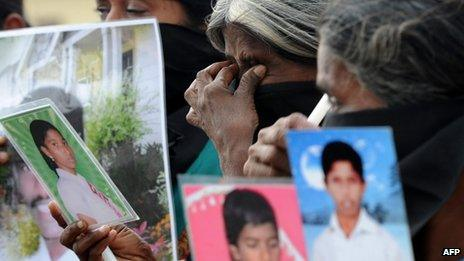 """Sri Lankan Tamil mothers from the """"Dead and Missing Persons' Parents"""" hold photgraphs during a protest in Jaffna, in northern Sri Lanka"""