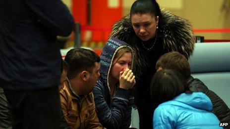 Relatives cry at Kazan airport. Photo: 17 November 2013