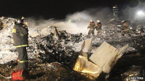 Rescue workers working at the crash site