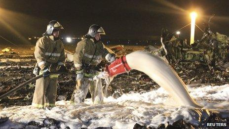 Russian Emergencies Ministry members and firefighters work at the crash site