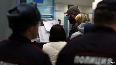 Relatives read a list of dead passengers at Kazan airport