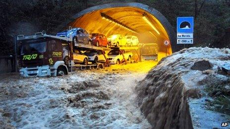 A truck and a bus are stranded by flood waters in a tunnel near Olbia