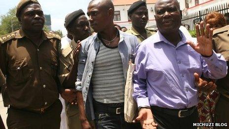Nguza Viking, known as Babu Seya (R) and his son Johnson Nguza, known as Papii Kocha (C) at a court appearance in Dar es Salaam in October 2013