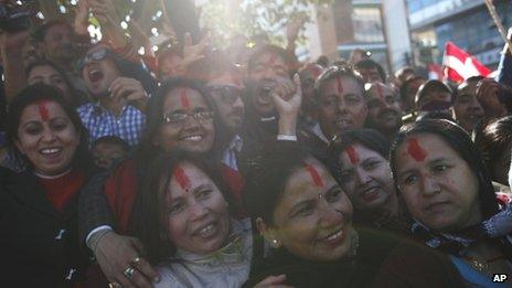 Nepali Congress party supporters celebrate outside a vote counting centre after initial results showed their candidates winning in Kathmandu