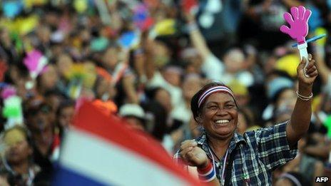 A Thai opposition protester waves a clapper during a rally at Democracy Monument in Bangkok on 24 November 2013