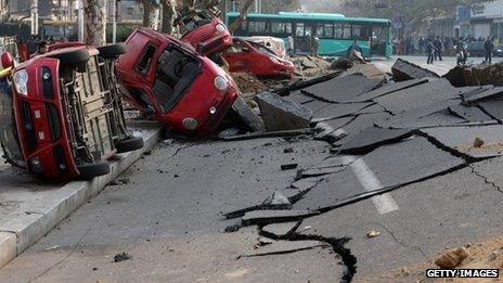 A general view of the damage after a oil pipeline exploded in Qingdao, China, on 22 November 2013