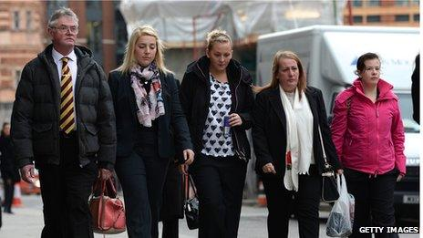Family members and loved ones of murdered soldier Lee Rigby, Ian Rigby, his stepfather (L), his sister Sara McClure (C) and his mother Lyn Rigby (2-R) arrive at the Old Bailey in London on November 29, 2013