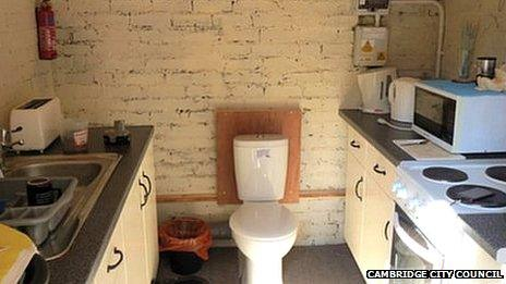 Kitchen with toilet in the middle
