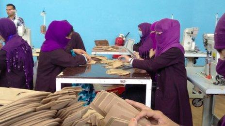 Workers at the shoe factory in Kabul that subsequently shut down
