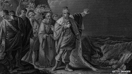 King Canute attempting to hold back the tide