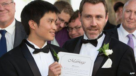 A couple hold their marriage certificate after being married at Canberra's Old Parliament House in Australia, 7 December 2013