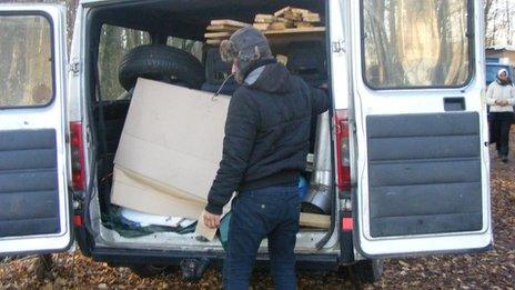 Roma empties after picking up discarded items
