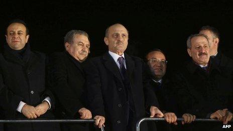 The three ministers to resign - Zafer Caglayan (R), Erdogan Bayraktar (2R) and Muammer Guler (2L) - at Ankara airport to meet the returning PM on 24 Dec