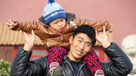 Father and son on visit to Tiananmen Square in Beijing - 5 December