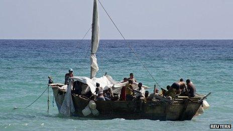 A boat of Cuban migrants floats anchored as they rest on their way from Cuba, May 23, 2013.