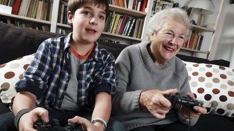 Boy and grandmother playing video game