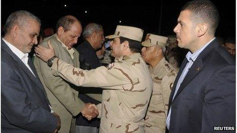 Egypt's Army Chief comforts the father of one of the officers killed
