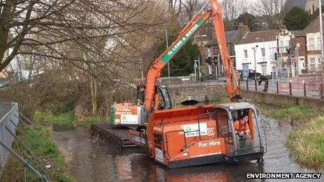 Dredging - shown here in east London - would not stop floods in Somerset, says the Environment Agency