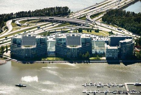 An aerial view of Nokia's headquarters near Helsinki, showing a big building complex surrounded by water